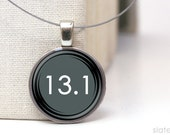 13.1 running pendant necklace on repurposed coin