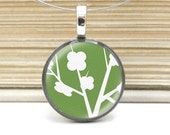 green autumn blooms necklace on repurposed coin