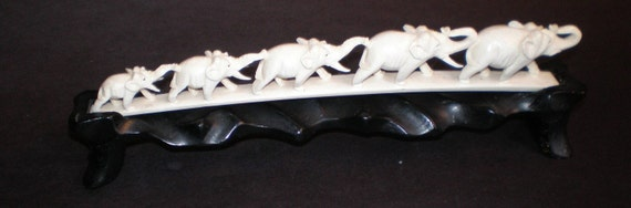 Old Carved IVORY tusk  five elephants in a row trunk to tail with WOOD STAND