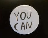 YOU CAN.  2 inch pin