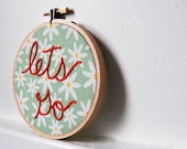 Lets Go. Daisies with Green and Orange, Hand Embroidery in 4 inch Hoop. By merriweathercouncil on Etsy