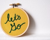 Embroidered Text in 3 inch Hoop/ Emerald Green on Mustard Yellow. Miniature Fiber Art. By merriweathercouncil on Etsy