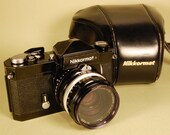 Classic black NIKON Nikkormat FTN camera, f2 lens and case. Ready to shoot.
