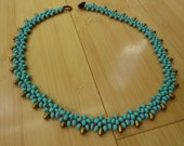 Handmade Turquoise woven necklace with button closure by  Dee Andersen