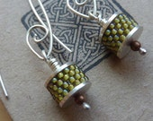 Handmade drop earrings made with woven yellow /green seed beads and silver  disks, by Dee Andersen