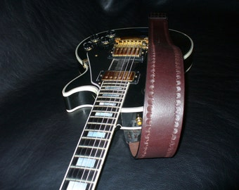 Handmade brown leather guitar strap. Hand tooled.