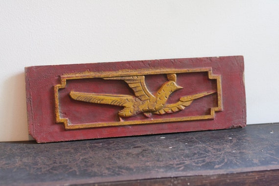 Carved bird, salvaged wood panel, red and yellow