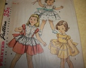 Vintage 1950s Simplicity Girls One Piece Dress with Short Puffed Sleeves Sewing Pattern Size 2 4591