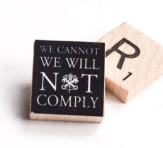 We cannot -- we will not-- comply  tie tack / lapel pin