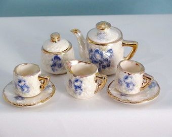 mini teaset with delicate blue flowers and 22kt gold