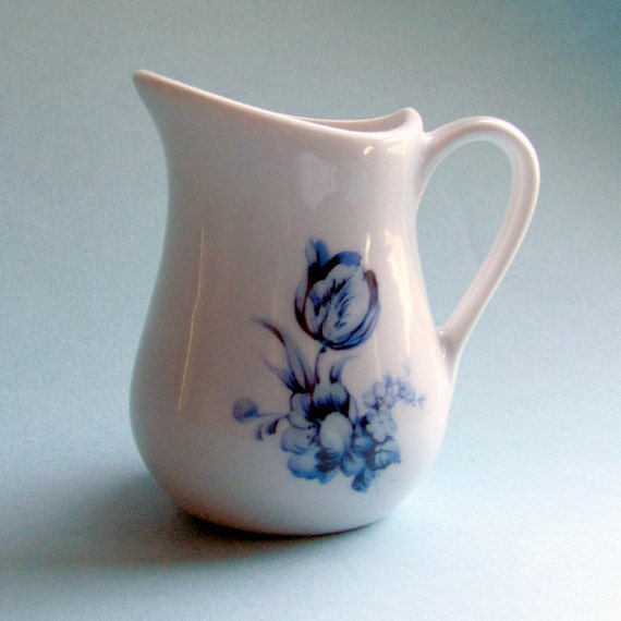 Small blue and white farmhouse style pitcher with Delft style flowers