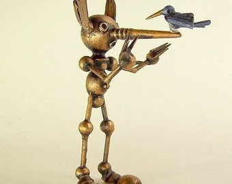 Pinocchio Wood Puppet Figure with Donkey Ears and Blue Bird on Nose The Original Robot Boy