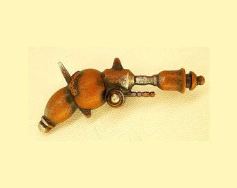 Ancient Rusty Grock Annihilator Retro Ray Gun Wood Pendant Ornament Science Fiction Dangle