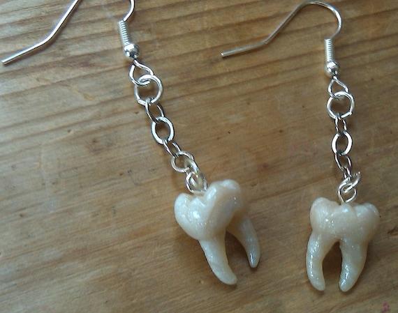 human teeth earrings