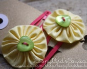 Yo Yo Hair Clips - Yellow with Green Heart Buttons on Pink Clip