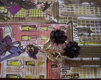 Vintage brooch with black roses