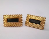 Scroll edge black center gold tone cuff links