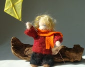 Waldorf wool felted boy with a kite