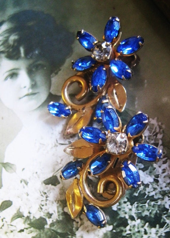 10% Off (cupon code marchmadness1) Vintage Coro Clip Earrings Beautiful Blue Glass Sapphire Flowers with Soft Brass Gold Patina