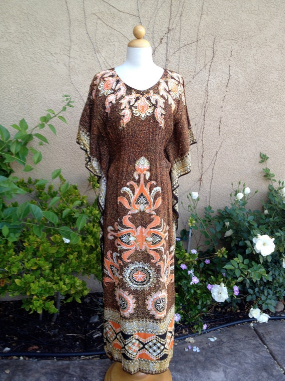A vintage 1960s 1970s brown and orange ethnic cotton bohemian hippie kaftan batik maxi batwing dress size M L