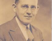 Man in Tie Wearing Glasses - Vintage Photograph, Vernacular, Ephemera