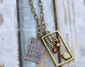 Bohemian styled mixed metal -let your life speak -  necklace with bird pendant and crystal drops