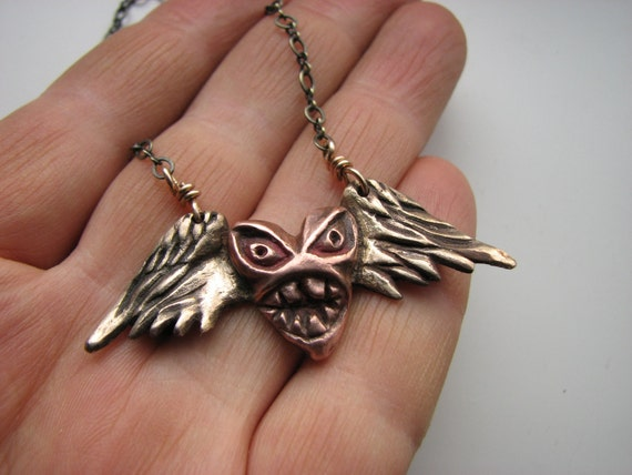 Heart wing monster pendant sculpture
