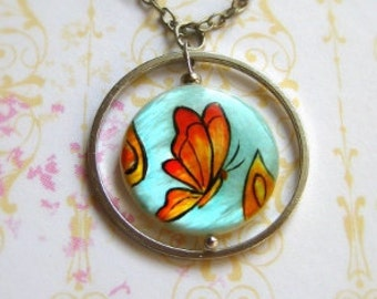 Butterfly necklace painted on mother of pearl, handpainted jewelry, artisan jewelry, panted by hand necklace, red yellow blue