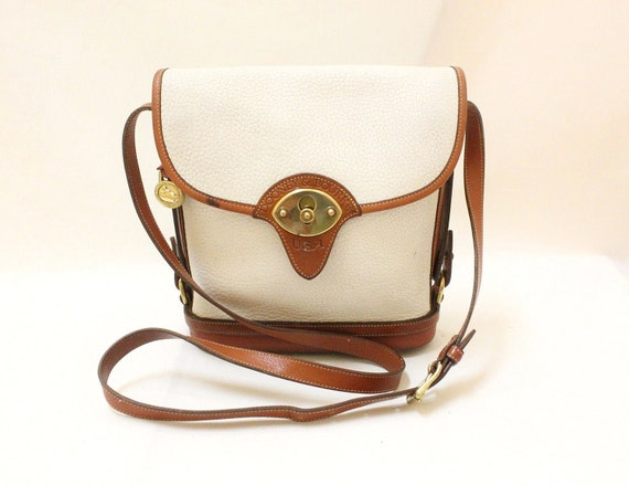 Dooney and Bourke Ivory  Pebble leather and tan color leather trim  Cross Body Shoulder Bag.