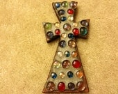 Brown wooden colorful jeweled cross