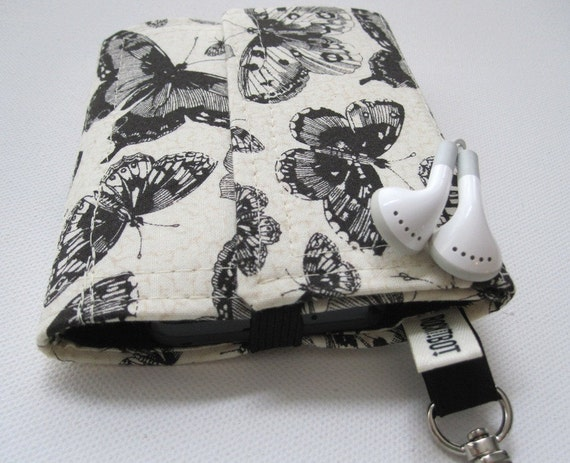 Nerd Herder gadget wallet in Lepidopterology for iPhone, Android, iPod, metronome, camera, earbuds, SD cards, USB, guitar picks, IDs, phone