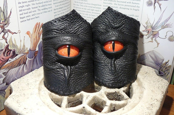 Pair of Wrist Bracers (Black leather with Red Orange Dragon eyes)