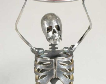 Zombie Skeleton Standing Holding Candle Holder Over Head