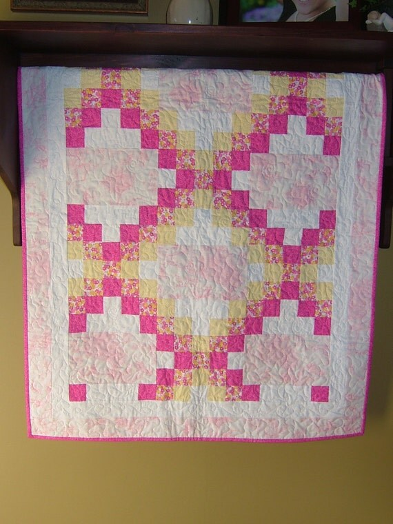 Crib size Irish chain Quilt featuring a toile nursery print in pink , yellow, and white