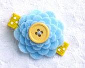 Felt flower hair clip in light blue and yellow