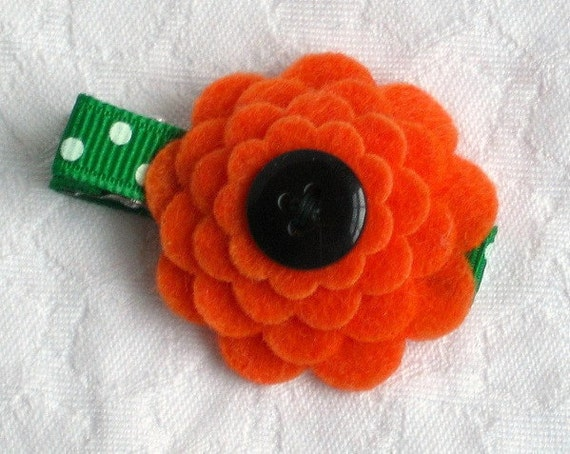 Felt flower hair clip fall colors in orange green and black button