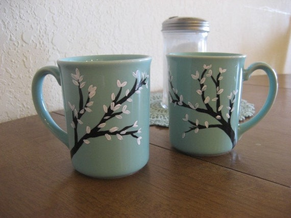 hand painted coffee mugs with trees and white leaves