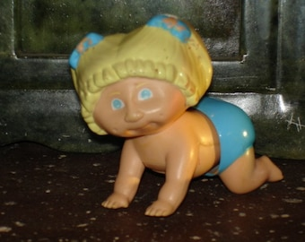 vintage 1980s Cabbage Patch Kid plastic tomy white knob crawling wind up toy