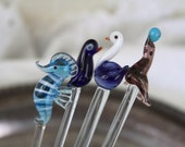 SET OF FOUR -- handmade glass swizzle sticks -- blue and white water animal theme -- sea horse swan penguin seal with ball -- 19