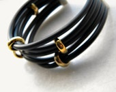 Impress me  bracelet - Black rubber cord with golden charms