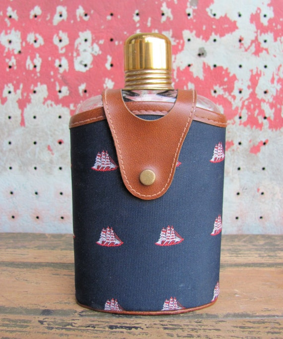 vintage c. 1960s nautical flask // glass with faux leather and sailboat fabric jacket