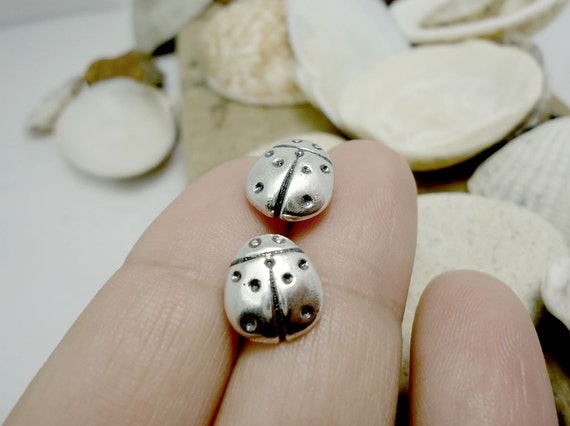 Ladybug studs in sterling silver. Casting in sand