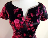 Hold for CINDY CHRISTIAN DIOR Couture 1950's vintage dress. Black Silk, Fuschia Pink Velvet Floral Print. Boned, Nipped Waist.