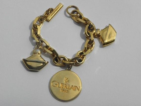 Guerlain Paris vintage designer charms bracelet gold plated huge, very elegant
