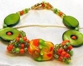 SAY BYE CLEARANCE Treasury Item SuMMER FuN a Green, Orange and Red Artisan Lampwork Bead Bracelet