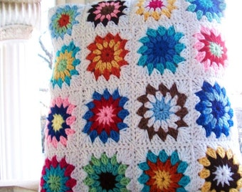 crocheted pillow sham with button closure measuring 18 inches square