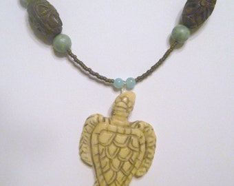 Bone honu and wood bead necklace