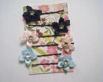 Satin and rhinestone flower pins