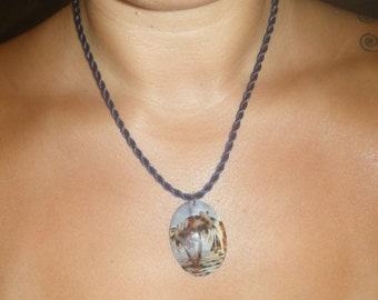 Beach scene carved cowrie shell necklace