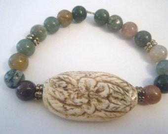 Plumeria carved antiqued bone bracelet with fancy jasper